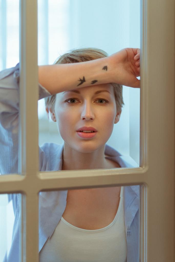 Anna through window